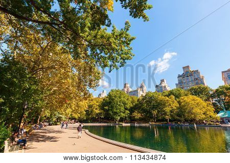 NEW YORK CITY - OCTOBER 07, 2015: lake in Central Park with unidentified people. The Central Park is the most visited urban park in the US as well as one of most filmed locations in the world.