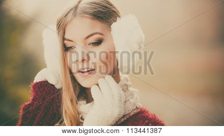 Portrait Of Pretty Gorgeous Woman In Earmuffs.