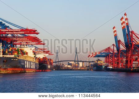 HAMBURG, GERMANY - MARCH 10: container cranes in the harbor on March 10, 2014 in Hamburg. The harbor of Hamburg is the largest sea harbor in Germany and under the 20 largest harbors of the world.