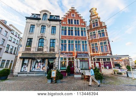 GHENT, BELGIUM - SEPTEMBER 02, 2015: old buildings at the Graslei with unidentified people. Ghent is famous for the medieval old town and is Belgiums 2nd largest municipality by number of inhabitants
