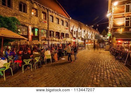 GHENT, BELGIUM - SEPTEMBER 01, 2015: restaurants at the Graslei in Ghent at night, with unidentified people. With about 240,000 Ghent is Belgiums 2nd largest municipality by number of inhabitants