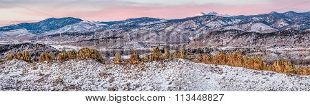 Panorama of Devil's Backbone and Longs Peak at sunrise in winter scenery, Loveland in northern Colorado
