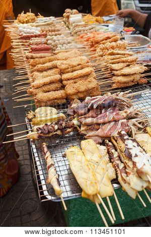 cookshop in Bangkok, Thailand, with various skewers and other meat