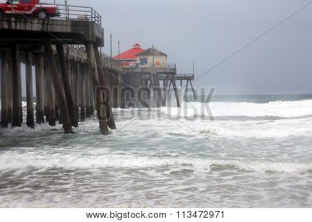 Huntington Beach CA: 1-6-2016, The Huntington Beach pier is pounded by High Surf as the El Nino Storm of 2016 makes landfall and causes flooding and damage all around southern California.