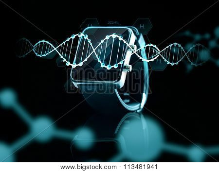close up of black smart watch over dna molecules