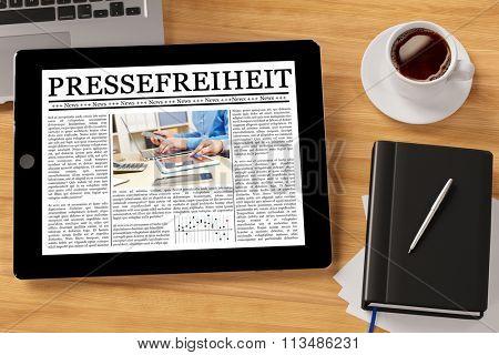 Tablet computer with the German slogan Pressefreiheit (freedom of speech) (3D Rendering)