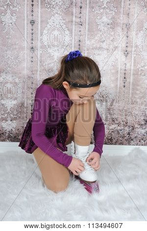 Sweet Young Figure Skater Tying Her Skates
