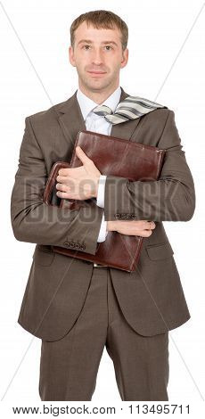 Businessman hugging suitcase
