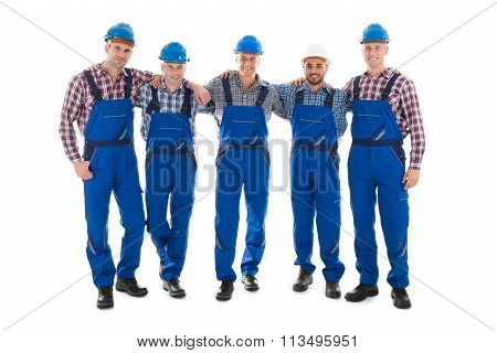 Confident Male Carpenters Standing With Arms Around