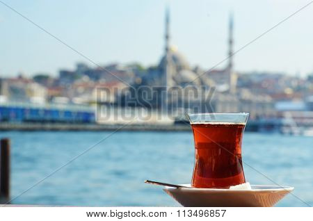 Close-up of a Turkish tea with Istanbul in the background
