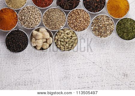 arrangement of spices on the whith sackcloth