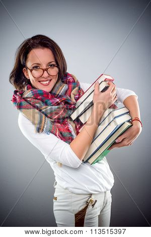 Trendy Attractive Woman Carrying A Pile Of Books