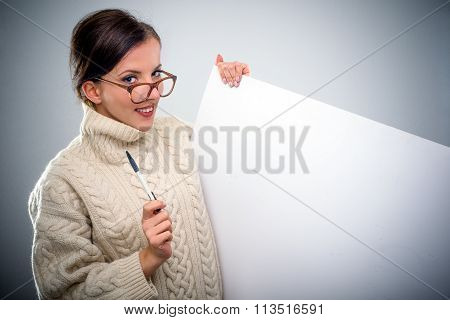 Smiling Scholarly Young Woman With A Sign