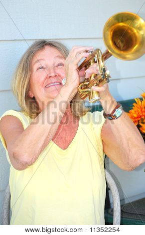 Happy female trumpet player.