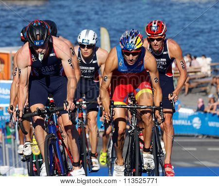 STOCKHOLM SWEDEN - AUG 23 2015: Stuggeling triathlon competitors including Mario Mola cycling uphill in the Men's ITU World Triathlon series event August 23 2015 in Stockholm Sweden