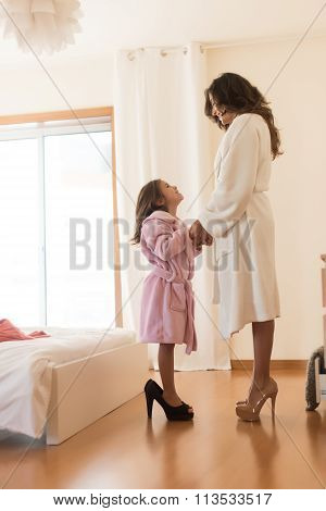 Kid Wearing Heels With Her Mother