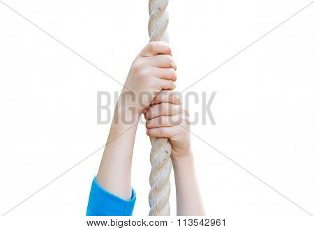 children's hands holding the rope