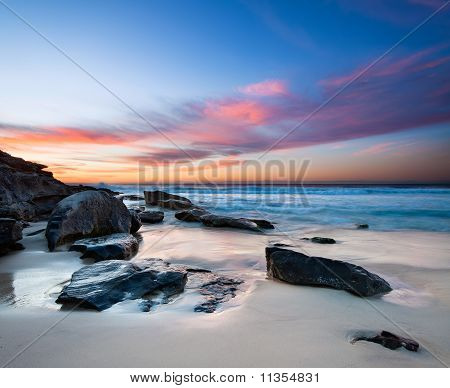 Interesting Beach With Rocks In Foreground