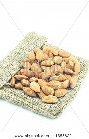Almonds On The Sack Isolated On White Background