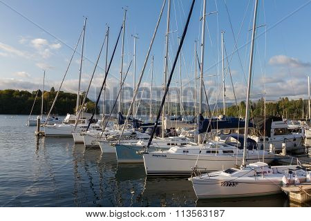 Luxury Sail Yachts Moored Along A Pier  In Bowness-on-windermere On Lake Windermere In Cumbria