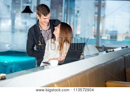 Loving couple in cafe with laptop, selective focus