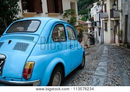 Small italian car on narrow road in village Scilla