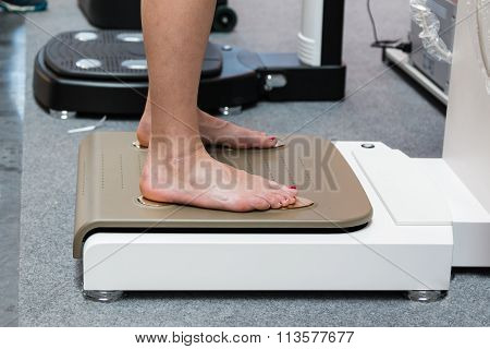 Feet On Medical Professional Scale: Health Checks Before Sport Activity