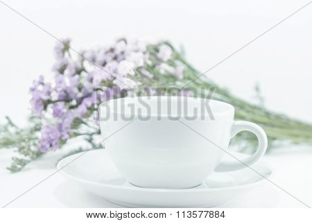 White Mug Cup And Static Flower