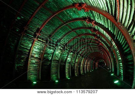Green light tunnel in underground salt cathedral Zipaquira
