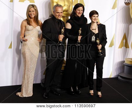 Jennifer Aniston, Mathilde Bonnefoy, Laura Poitras and Dirk Wilutzky at the 87th Annual Academy Awards - Press Room held at the Loews Hollywood Hotel in Los Angeles, USA February 22, 2015.