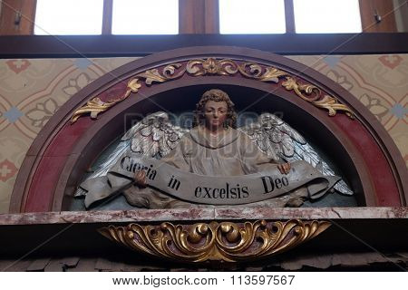 STITAR, CROATIA - AUGUST 27: Angel with Gloria in excelsis Deo Banner, Nativity Scene, altarpiece in the church of Saint Matthew in Stitar, Croatia on August 27, 2015