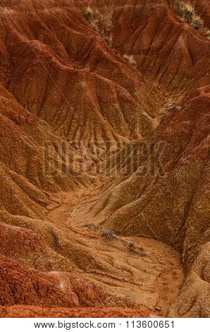 Dry valley red orange sand stone rock formation in hot desert of Tatacoa, Huila