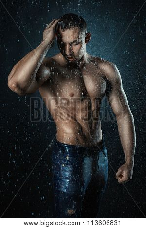 Man Bodybuilder Shakes Off Water From His Hair.