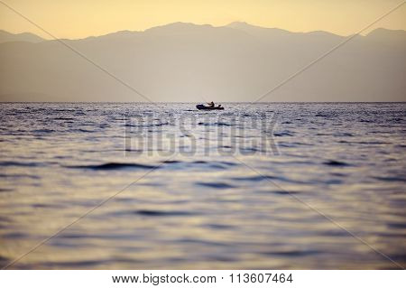 Fisherman On Ohrid Lake At Sunset