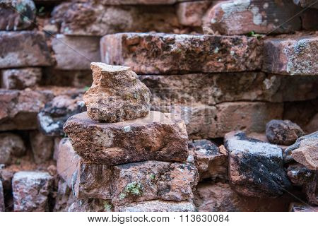 Old And Broken Red Stone Brick Wall