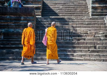 Two Monks Walking On Stone Stair