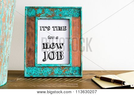 Vintage Photo Frame On Wooden Table With Text It's Time For A New Job