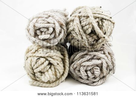 Four Balls Of Neutral Colored Yarn