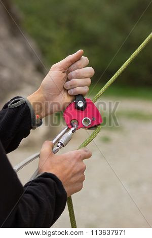 Insurance climber using ropes and belay device in action poster