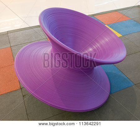 Giant Purple Spinning Tops In Kid Playground