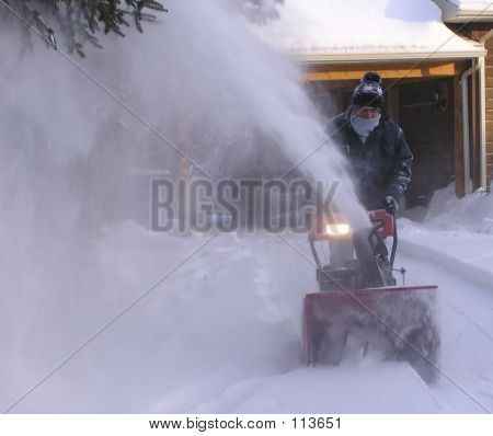 baby boomer senior blowing snow on first day of December in Quebec poster