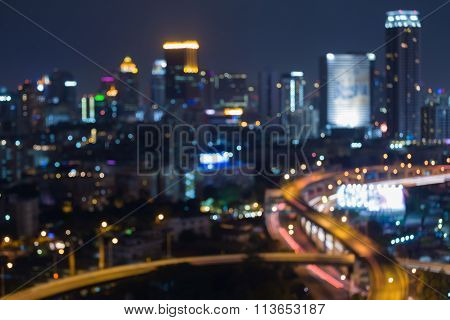 Abstract blurred bokeh lights, city night road intersection