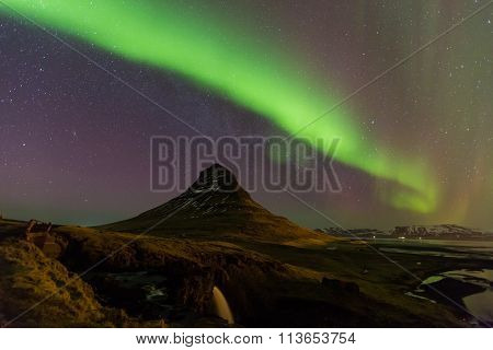Northern lights or Aurora dancing with fully of stars on the sky of Iceland mountain landscape.