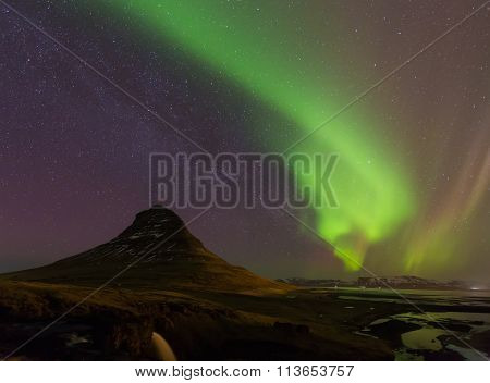 Beautiful aurora dancing with fully of stars on the sky
