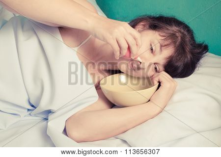 Woman Flushing Her Nose.