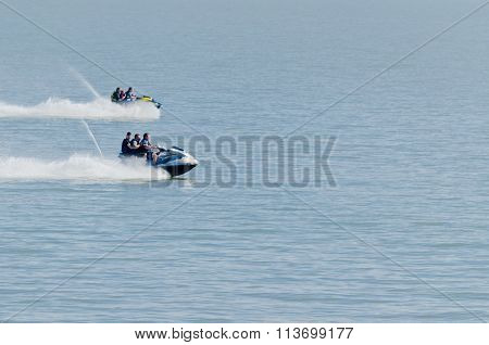 Two groups of jet skiers in a race