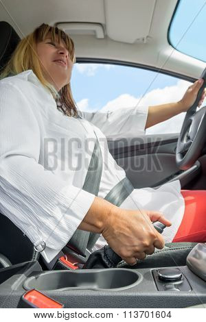 Portrait Of A Woman In A Car Holding The Handbrake