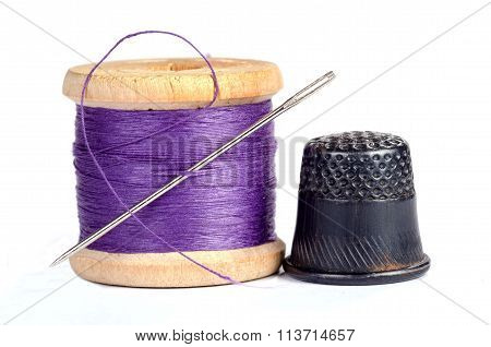 Old Thimble And Needle With Thread