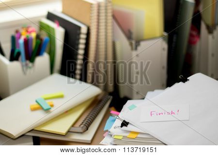 Finish; Stack Of Documents. Working Or Studying At Messy Desk.
