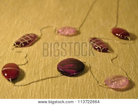 Lilac beads on the mat